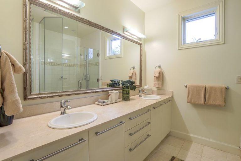 En suite upstairs bath has dual sinks