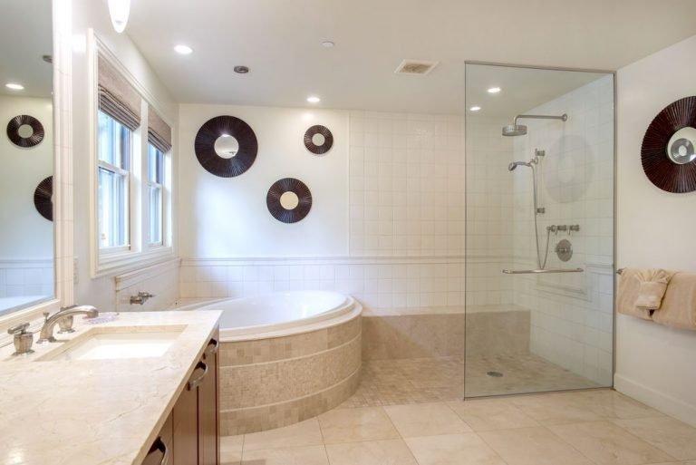 Ensuite master bath has dual sinks, whirlpool tub and shower