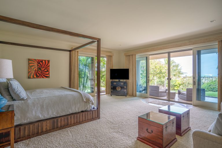Master bedroom includes large screen television