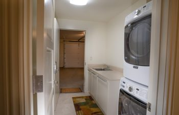 Washer and Dryer Room with Access to Garage